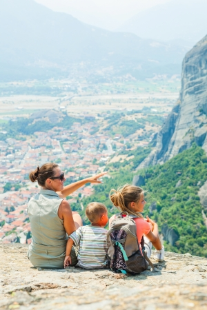 bird s eye: Mother and her kids looking at the town of Kalambaka bird s eye view  Vertical view  Meteora, Greece  Stock Photo