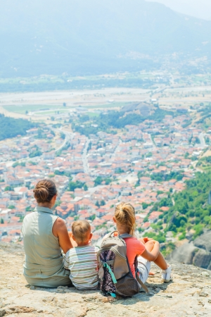 bird s eye view: Mother and her kids looking at the town of Kalambaka bird s eye view  Vertical view  Meteora, Greece  Stock Photo