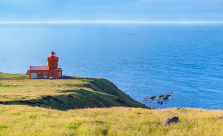 North Iceland Sea Landscape with Orange Lighthouse and Blue Sky  Panorama photo