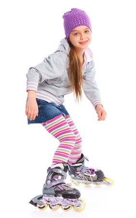 roller skates: Cute girl in roller skates on a white background Stock Photo