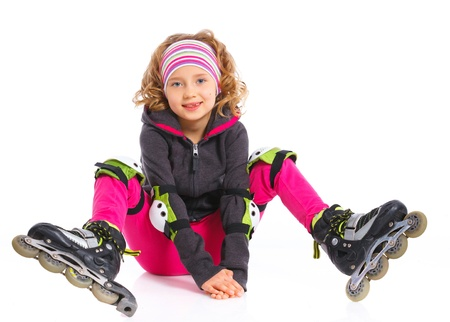 Cute girl in roller skates on a white background photo