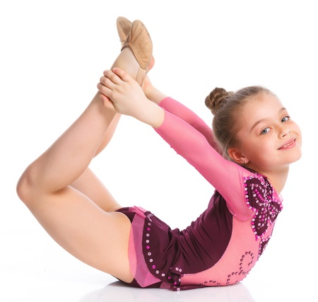 Young cute girl doing gymnastics over white background photo