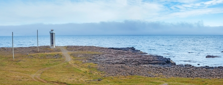 North Iceland Sea Landscape with Lighthouse and clouds Sky  Panorama photo