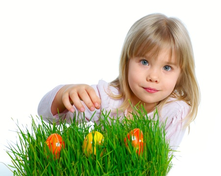 Adorable little girl collecting Easter eggs in her basket  Isolated white backround photo