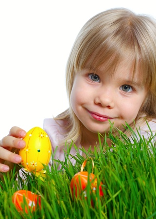 Adorable little girl collecting Easter eggs in her basket  Vertical view  Isolated white backround photo