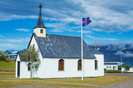 Remote Icelandic Lutheran church on the coast  Typical small simple structure of Icelandic churches Stock Photo - 17968067