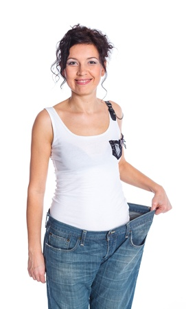 Slim woman trying large jeans after diet Stock Photo - 18065322