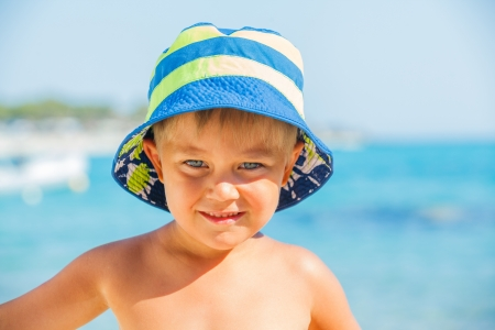 People series  portarit of boy on summer sea beach photo