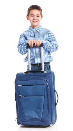carryall: The young traveler boy with a suitcase  Isolated over white background  Vertical view Stock Photo