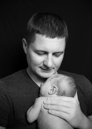 Father holding a newborn baby boy, 11 day old Stock Photo - 18282360