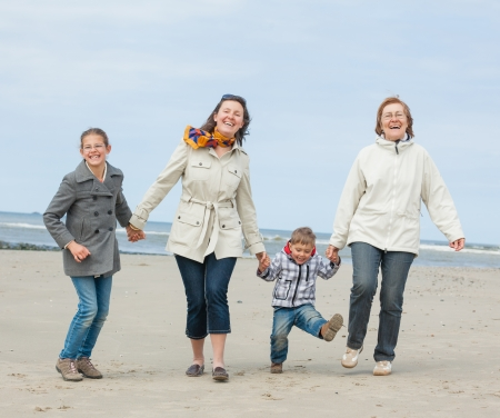 Cute young woman with two kids and grandmother having fun on the Dutch beach Stock Photo - 18521835