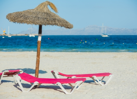 singleness: View of two chairs and umbrella on the beach