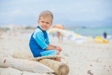 kiting: Cute 2 years old boy looking at kiting on tropical beach
