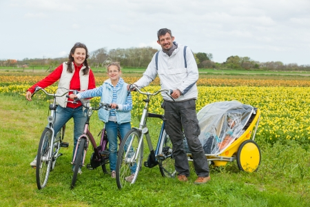 filed: Family of four with bicycle on a spring day in Holland