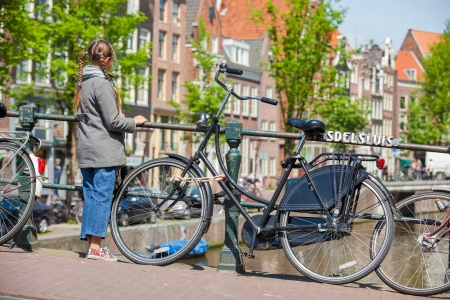 Happy pretty girl walking outdoors in Amsterdam Stock Photo - 18693500