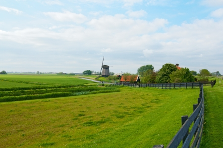 Landscape in Holland with windmills and a canal  photo