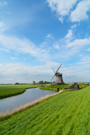 Landscape in Holland with windmills and a canal  Vertical view Stock Photo - 18960549
