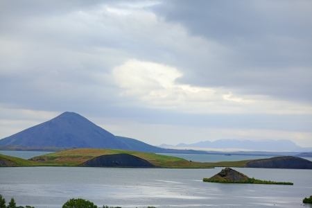 meer: Iceland landscape at summer cloudy day  Mountain lake Myvatn  Stock Photo