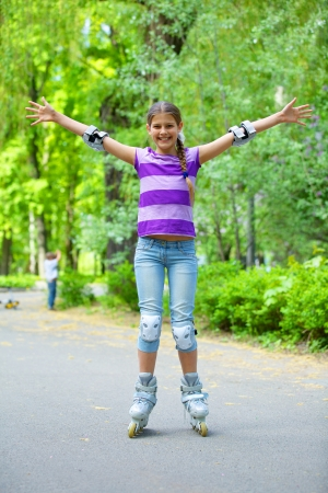 Beautiful girl in roller skates at a park photo
