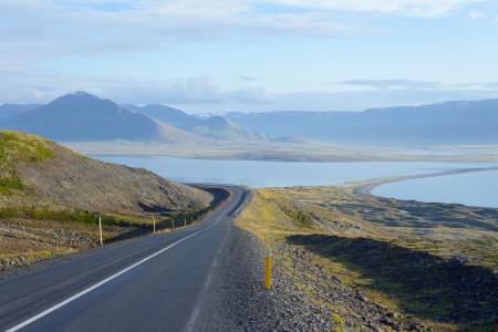 Highway through Iceland landscape at foggy day  Horizontal shot photo