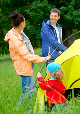 Family with doing camping in the park photo