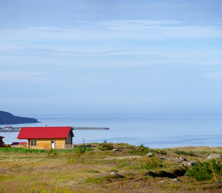 Beautiful house in Iceland  Mountains in background  Panorama photo