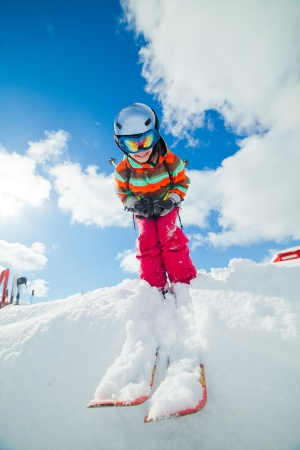 Girl on skis in soft snow on a sunny day in the mountains Stok Fotoğraf