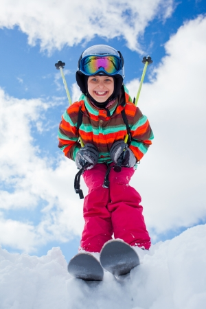 off piste: Girl on skis in soft snow on a sunny day in the mountains Stock Photo