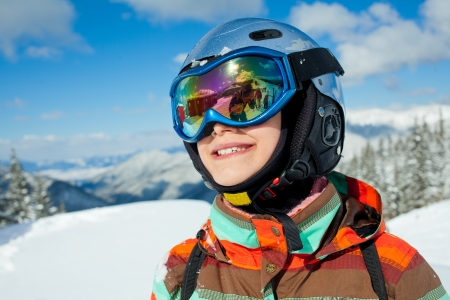 off piste: Portrait of girl on skis in soft snow on a sunny day in the mountains