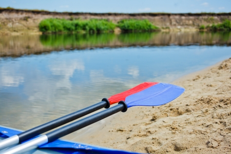 Red and blue paddles for white water rafting and kayaking photo