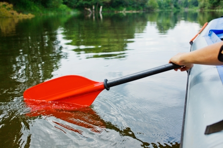 Red paddles for white water rafting and kayaking