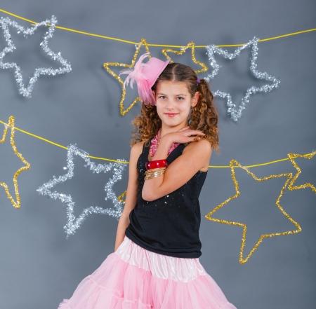 Fashion girl is wearing masquerade costume  Holiday theme Emotion child  photo