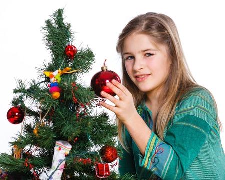 Christmas theme - Beautiful girl decorating christmas tree  Isolated on white backround  photo