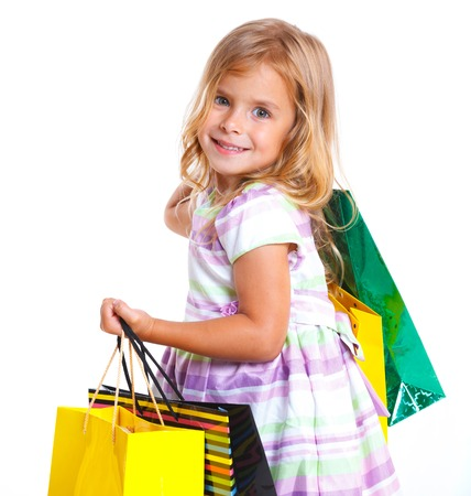 Shopping little girl happy smiling holding shopping bags  photo