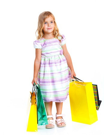 Shopping little girl happy smiling holding shopping bags isolated on white background  photo