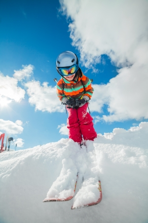 off piste: Girl on skis in soft snow in the mountains