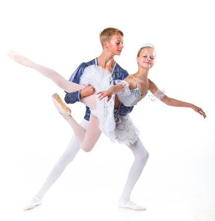 Couple of young ballet dancers posing over isolated white background Stock Photo - 23892444