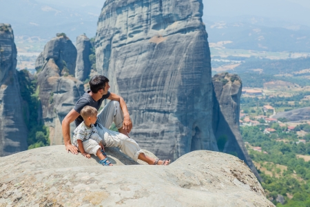 bird s eye: Father and son looking at the town of Kalambaka bird s eye view  Meteora, Greece