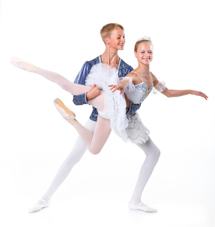 Couple of young ballet dancers posing over isolated white background Stock Photo - 23915159