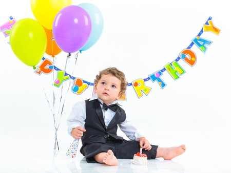 Babies  first birthday one year old with colorful balloons  Isolated over white