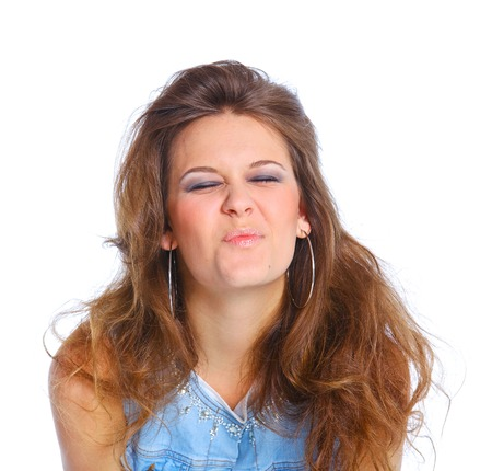 Teenager girl grimacing  Face portrait against white  Stock Photo
