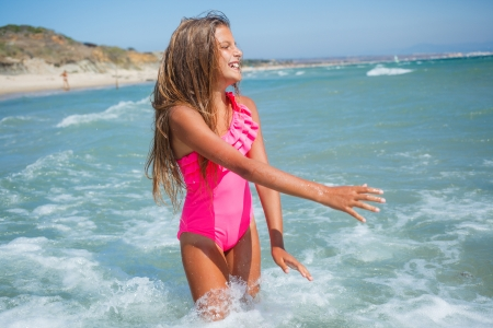 Beautiful happy smiling girl on beach vacation photo