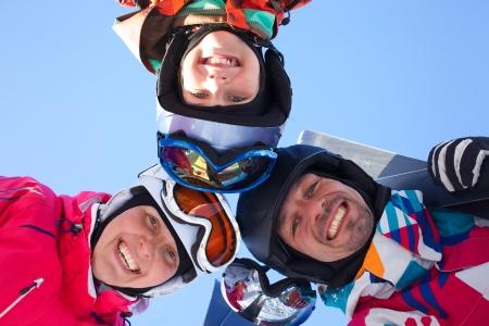 Skiing, winter, snow, skiers, sun and fun - family enjoying winter vacations photo