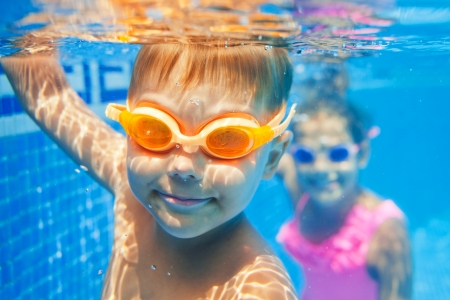 caucasian water drops: Close-up underwater portrait of the cute smiling boy