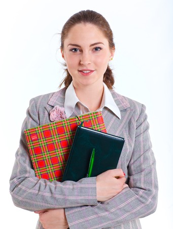 Portrait of university girl holding books and smiling  Isolated over white background  photo