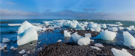not full: Beautiful beach in the South of Iceland with a black lava sand is full of icebergs from glaciers not far away  Panorama Stock Photo