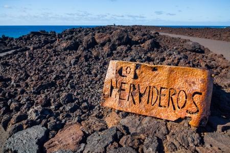 los hervideros: Los Hervideros, coastline in Lanzarote with waves and volcano