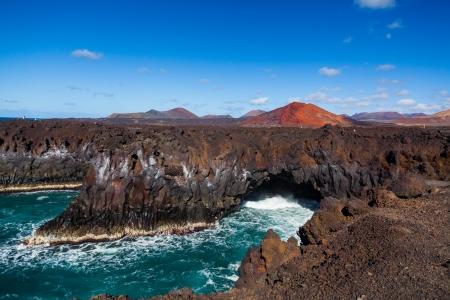 lanzarote: Los Hervideros, coastline in Lanzarote with waves and volcano