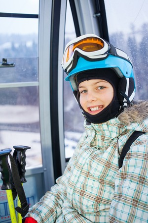 ski lift: Ski lift, skiing, ski resort - happy skier girl on ski lift