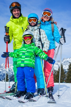 Ski, winter, snow, skiers, sun and fun - family enjoying winter vacations  photo